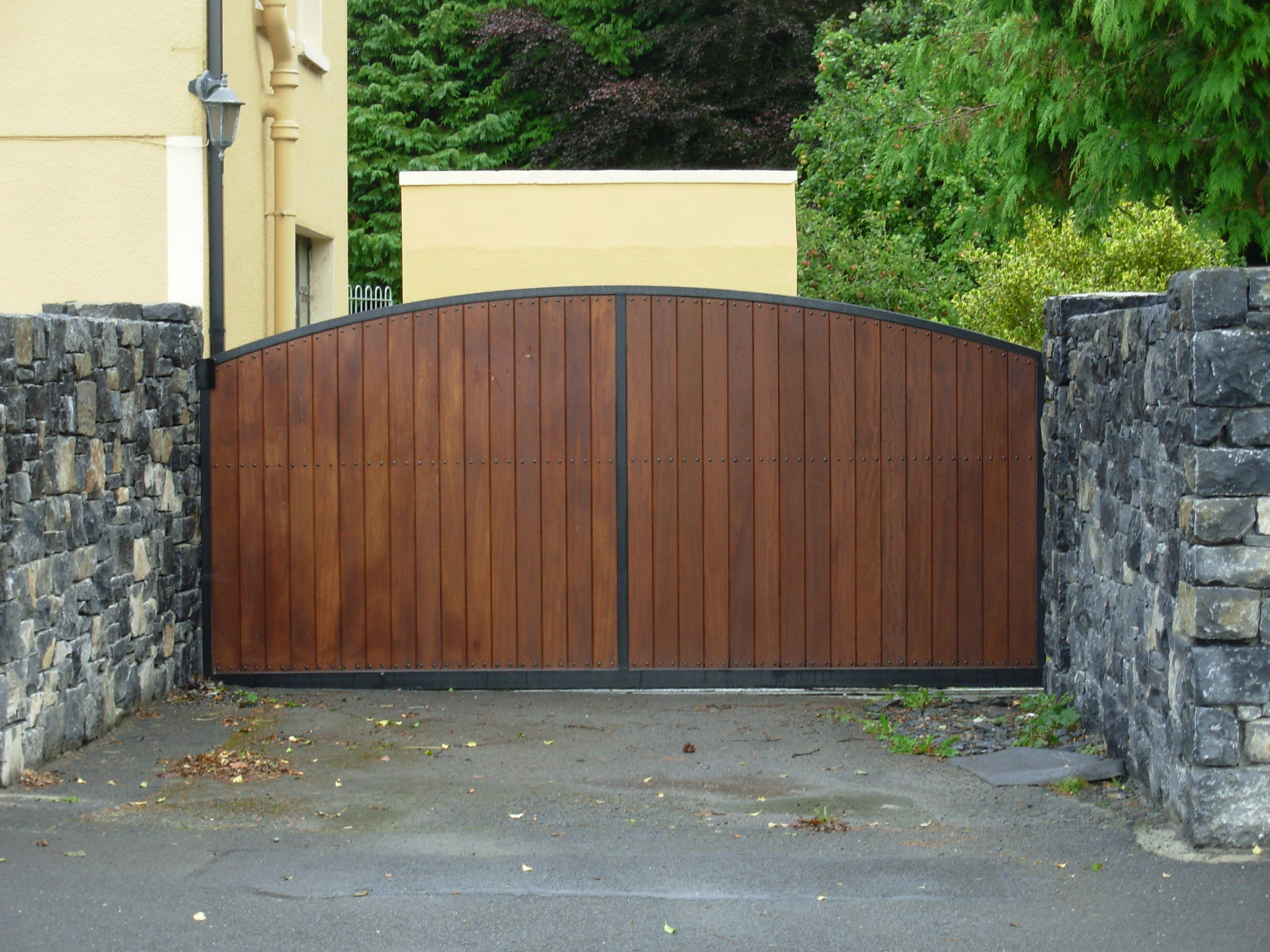 Wood and plastic clad sliding wooden infill gate ennis for Sliding driveway gate hardware